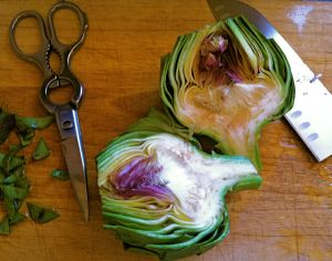 Photo of artichoke cut in half and trimmed
