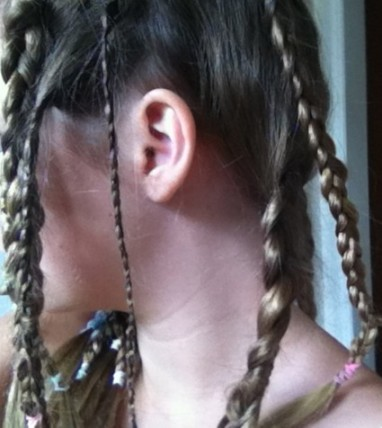 Profile of girl with braided hair.