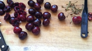 Photo of cherries on cutting board.